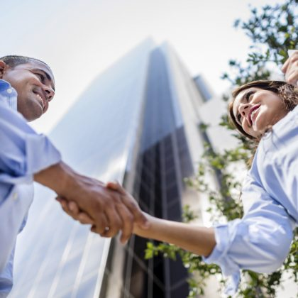 Successful business people handshaking and closing a deal