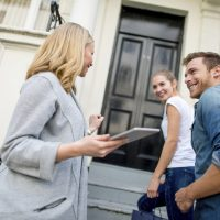 Couple buying a house with a real estate agent